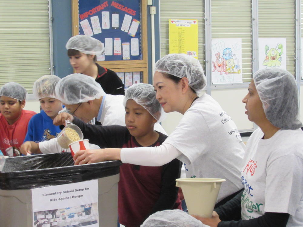 Brier students and volunteers pack meals for Kids Against Hunger.