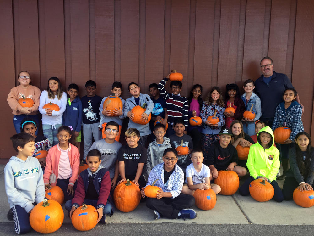 Mattos 5th-graders pose with their pumpkins.