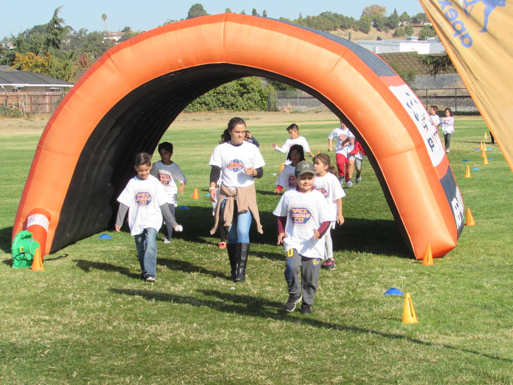 Grimmer students and staff circle the track at Turkey Trot Fun Run.