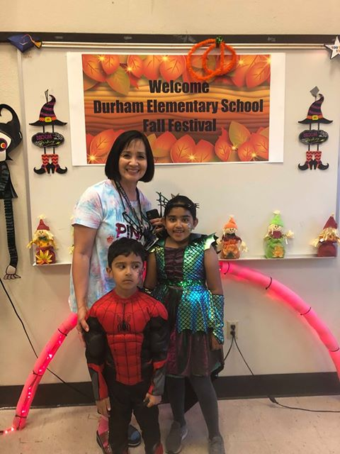 Durham Elementary Principal Teresa Bonaccorsi poses with students at Fall Festival.