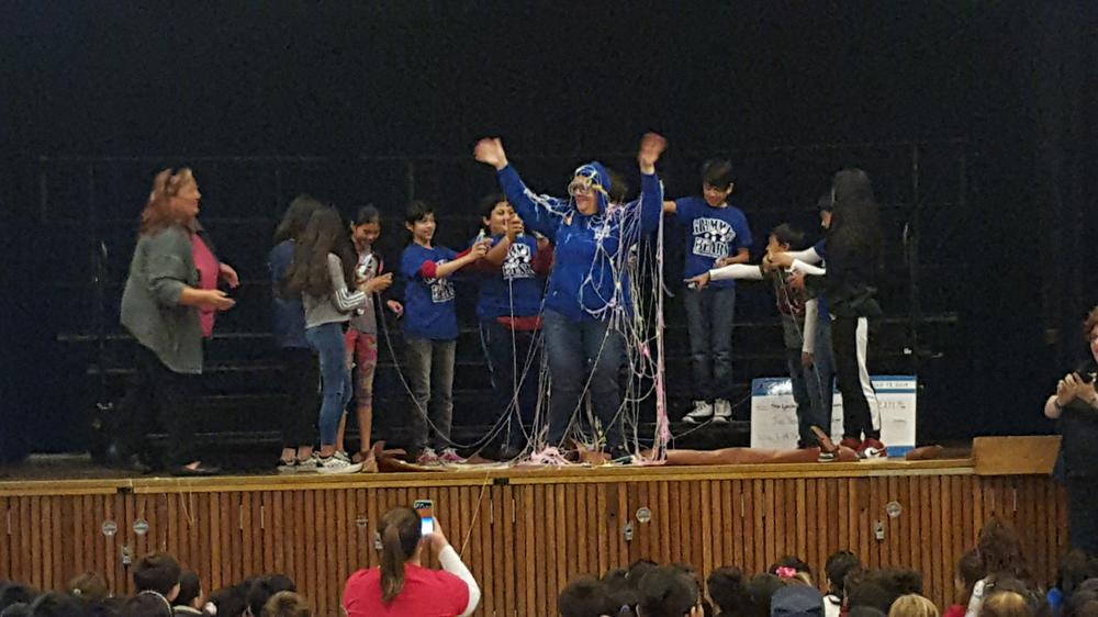 Ms. Nye is silly-stringed by Grimmer Elementary students.