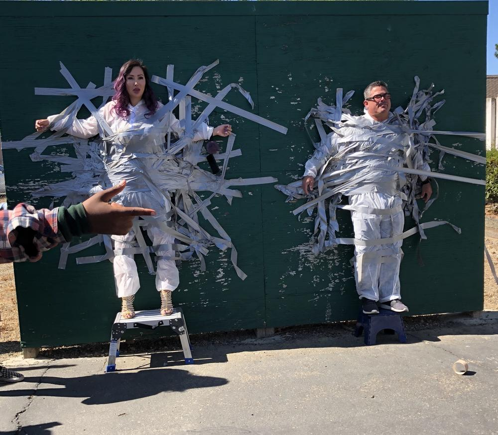 RObertson Principal Sal Herrera and Assistant Principal Amy Perez are taped to the wall for Spirit Week October 4th.