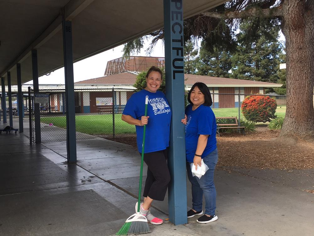 Hirsch Elementary staff clean up campus for Make a Difference Day.