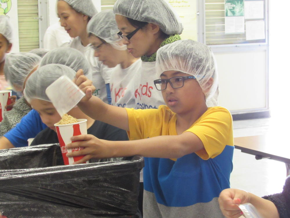 Brier student assembles a meal for packing at Kids Against Hunger event.