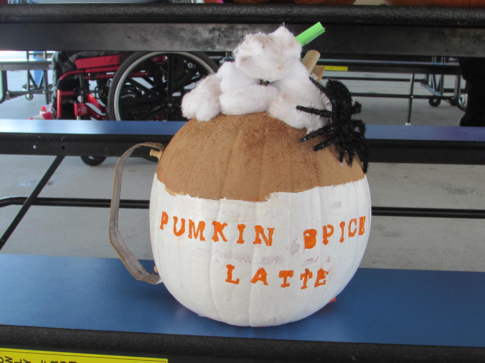 A Pumpkin-Spice Latte-decorated pumpkin.