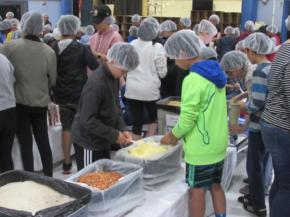 Weibel students and volunteers prepare meals for children around the world May 30th.