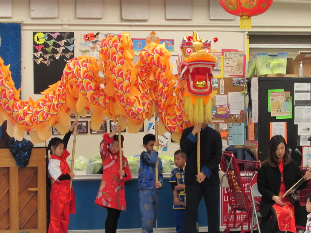 Dragon makes an appearance at Millard Elementary Lunar New Year assembly.