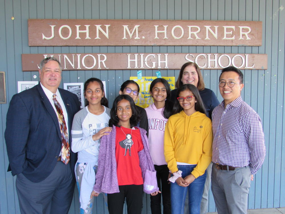 Representatives from AC Transit pose with Horner Junior High School  Wonder Girls.