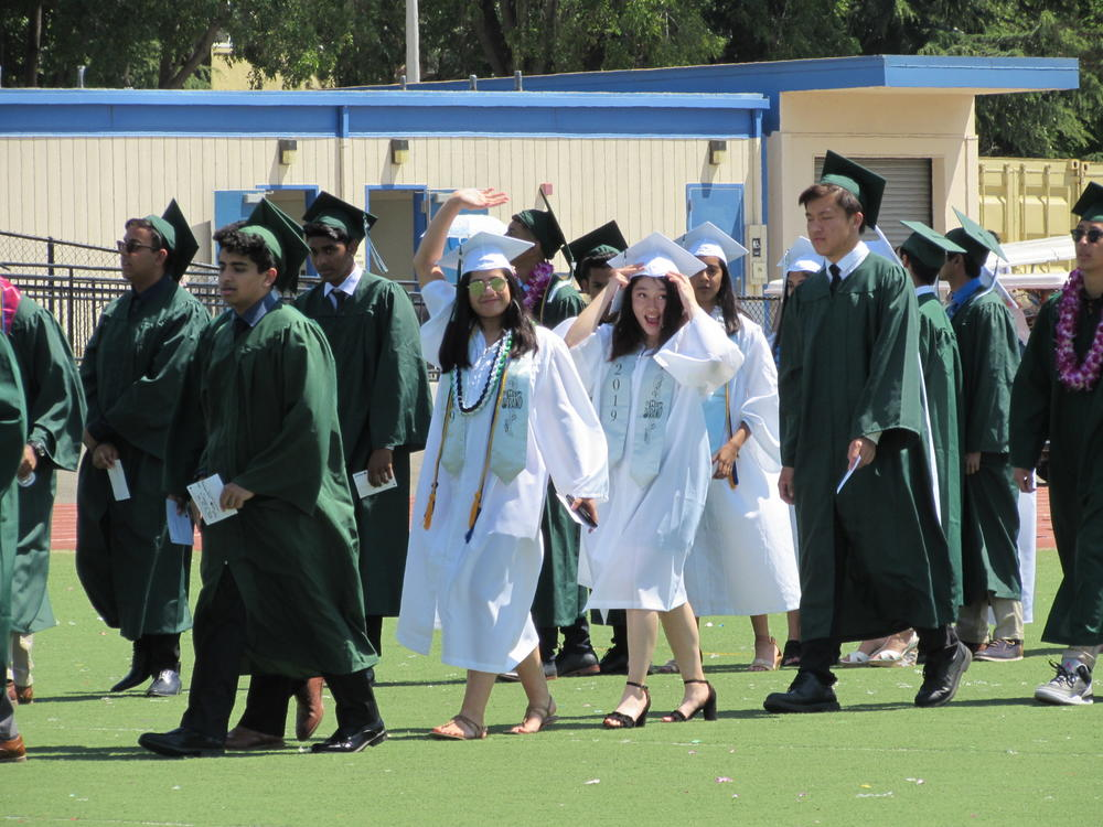 Mission San Jose seniors wave to the crowd during Graduation Ceremony June 13th.