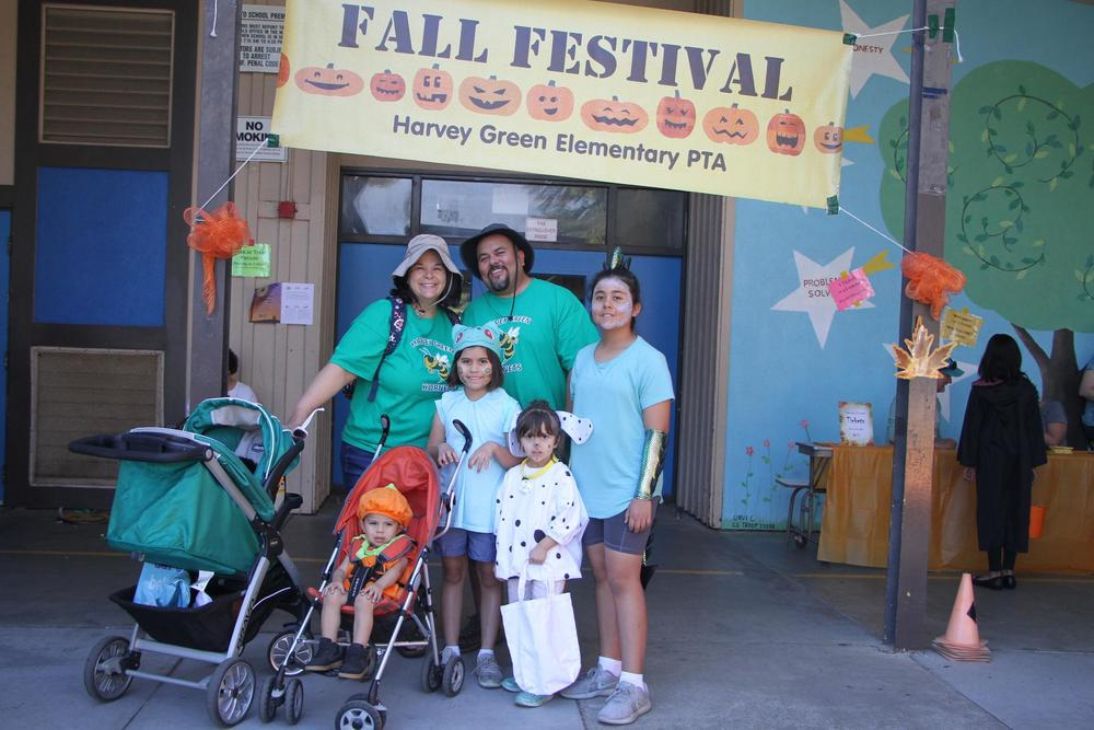 Green Elementary family poses at Fall Festival.