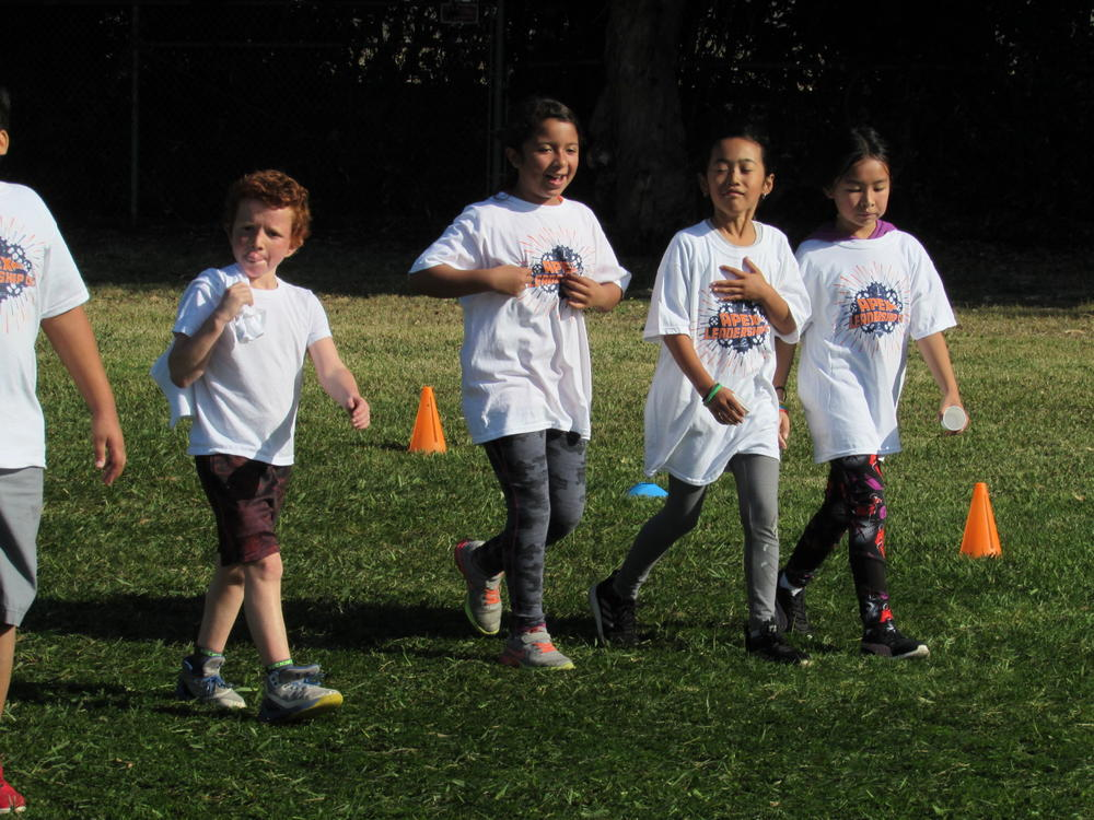 Grimmer students circle the track at Turkey Trot Fun Run.