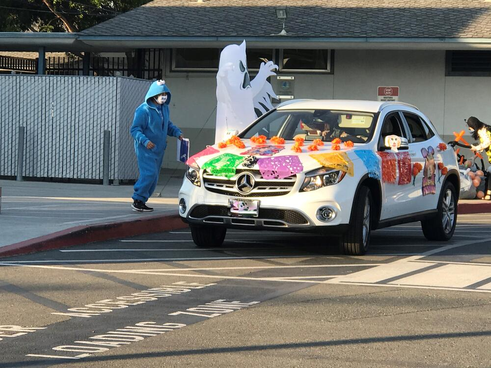 Halloween costume drive-thru parade at Grimmer Elementary.