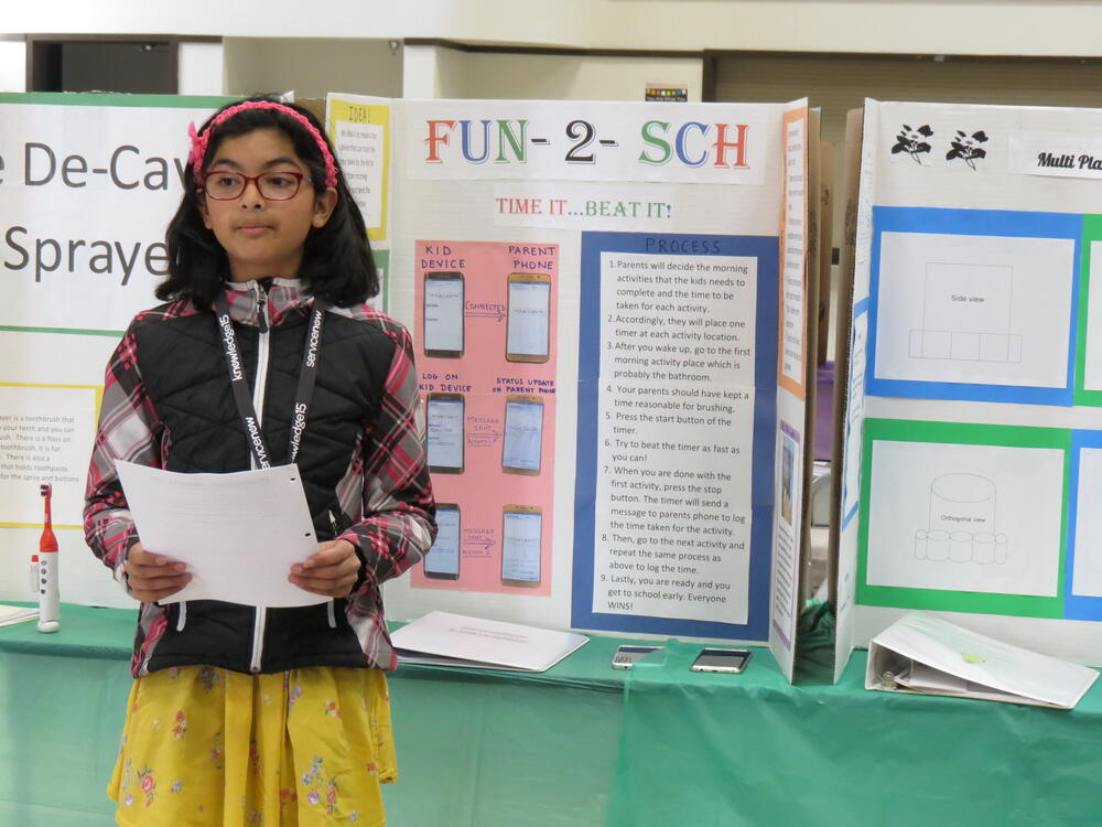 A Chadbourne Elementary student presents her invention.