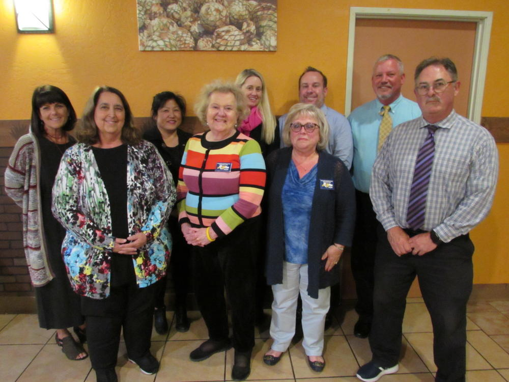 FUSD s three Classified employee of the year nominees pose with their principals and assistant principals.