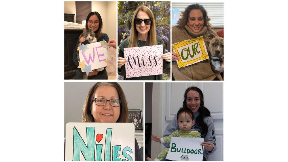 Niles staff hold signs for students #2