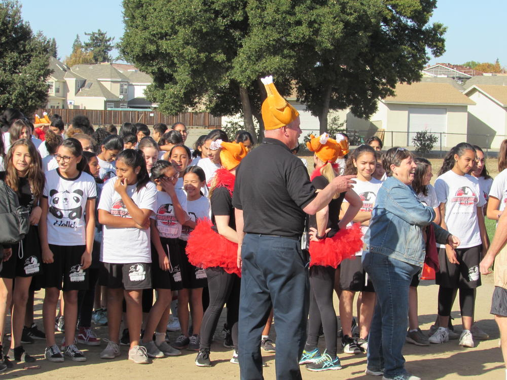 Centerville Principal Walter Lewis prepares students for Turkey Trot.