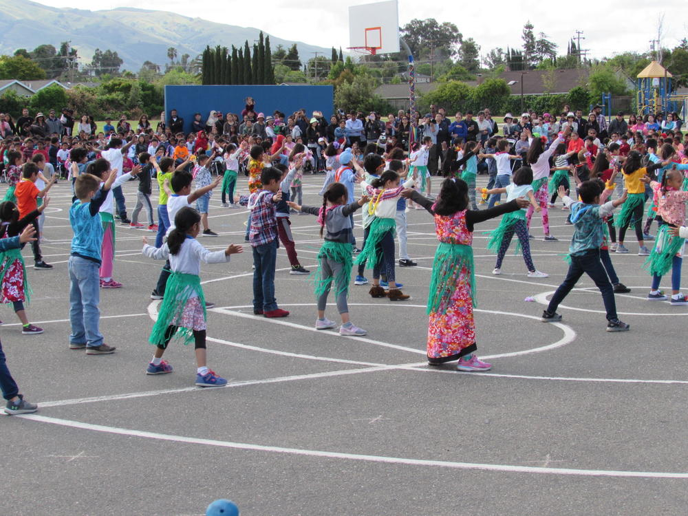 First-graders perform May Day Dance.