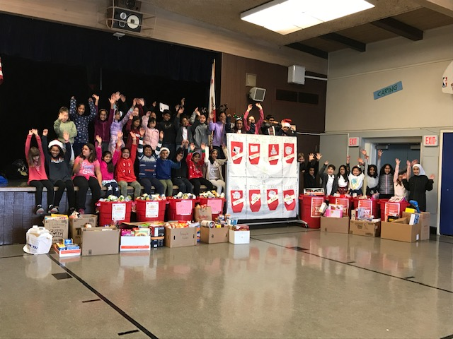 Oliveira students celebrate with collection of food and toys ready to donate.