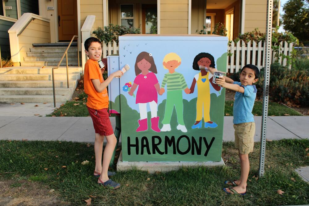 Hirsch Elementary siblings Ansh and Arush pose by their art project.