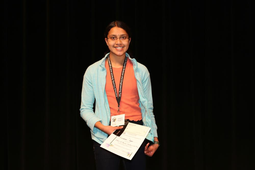 Honer Junior High School s Anoushka Iyer with awards from Alameda County Science Fair.