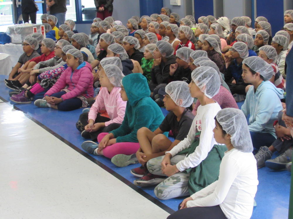 Weibel students listen to instructions before putting meals together for children around the world May 30th.