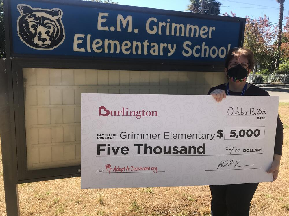 Grimmer Principal Judy Nye with  5,000 check from Burlington.