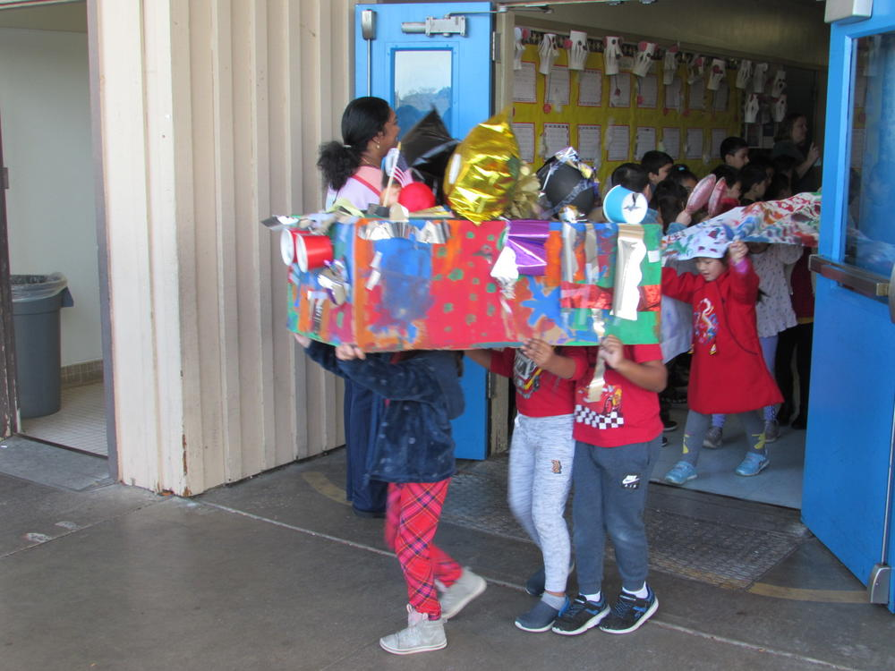 Kindergartners at Green Elementary march in Chinese New Year Parade.